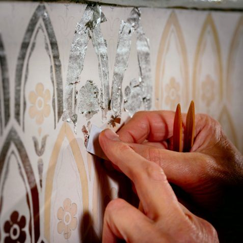 Applying the platinum leaf onto the motifs | Royal Pavilion and Museums Brighton & Hove