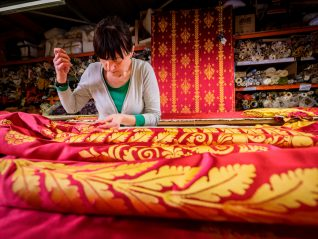 Silk drapes being finished by hand | Royal Pavilion and Museums Brighton & Hove