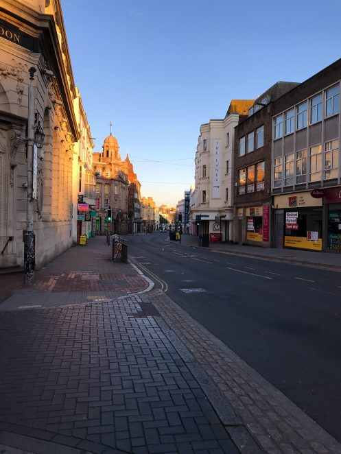 Empty pavements and road of North Street, central Brighton, on a Friday night during lockdown, Spring 2020 | Chloe Daniels