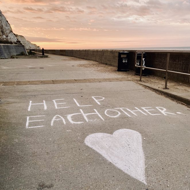 Help each other - chalk writing along the cliff path | Chris Barbara ARPS. All Rights Reserved.