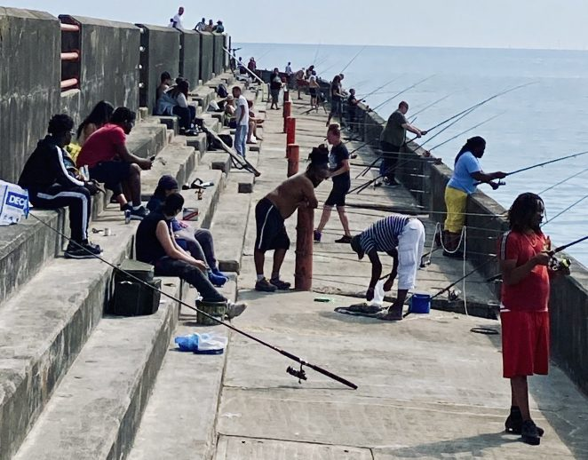 Fishermen on the breakwater of Brighton Marina as coronavirus lockdown rules were lifted | Chris Barbara ARPS. All Rights Reserved.