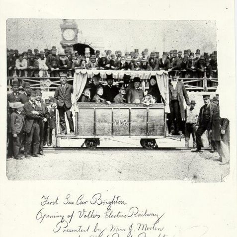 Opening day for Volks Railway, August 4th 1883.  Magnus Volk stands to the left of the photo dressed as a railway engineer. The Mayor Arthur Cox stands on the right in a top hat | Image reproduced with kind permission from Brighton and Hove in Pictures by Brighton and Hove City Council