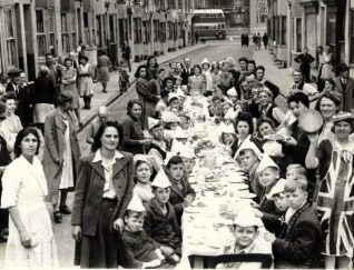 Photo of a Brighton street party - do you know anyone in this photo? Email jennifer@mybrightonandhove.org.uk   Image reproduced with permission from Brighton History Centre