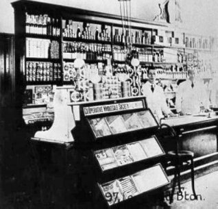 Co-operative Society Shop, c. 1910: Interior of the Co-operative Wholesale Society shop at 97 London Road, showing stocked shelves and sales staff. | Image reproduced with kind permission from Brighton and Hove in Pictures by Brighton and Hove City Council
