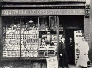 North Road Co-op with staff posing in the doorway. The store at 32 North Road opened in May 1888 | Image reproduced with kind permission from Brighton and Hove in Pictures by Brighton and Hove City Council