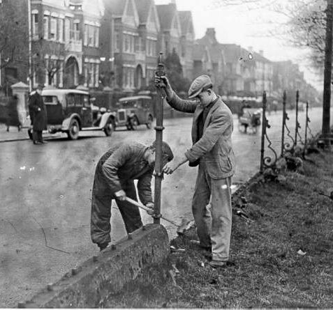 Removal of Railings from Preston Park Avenue, 1936: In 1928 Captain B. Maclaren launched a campaign to remove Victorian iron railings from Preston Park, as part of the former mayor Herbert Carden's plans to open up Brighton's parks and open spaces. | Image reproduced with kind permission from Brighton and Hove in Pictures by Brighton and Hove City Council