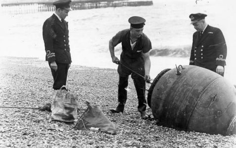 Removing a mine from the beach c1945