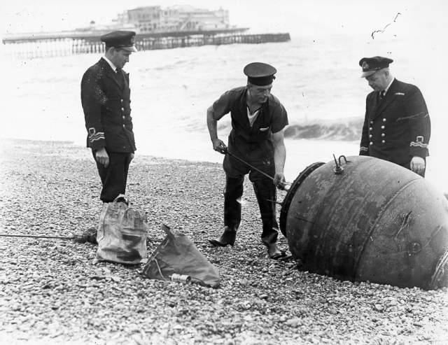 Personnel from HMS Vernon remove a mine from the beach c1945 | Image reproduced with kind permission of The Royal Pavilion and Museums Brighton and Hove