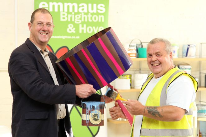 (L to R) Cllr Pete West, Brighton & Hove City Council's Cabinet Member for Sustainability, with Chris Hall, a companion at the Emmaus charity, one of the local community groups putting leftover paint to good use | Photo courtesy of Brighton and Hove City Council