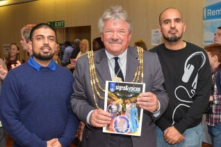 The Mayor with an edition of Signs and Voices - deaf super hero comic | Photo by Tony Mould