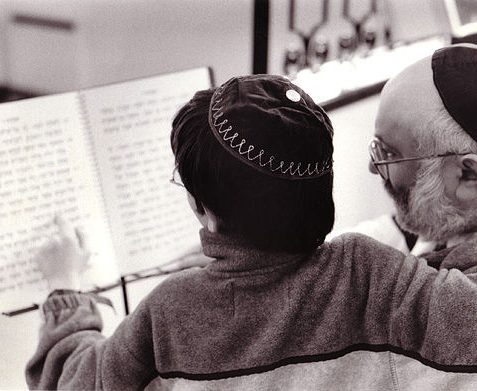 Studying the Torah, Brighton and Hove Progressive Synagogue, Lansdowne Road, Hove: Steve and his son Daniel | Reproduced with kind permission from Tony Tree