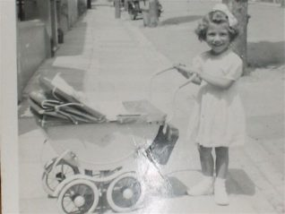 Sandra and her pram | From the private collection of Sandra Bohtlingk
