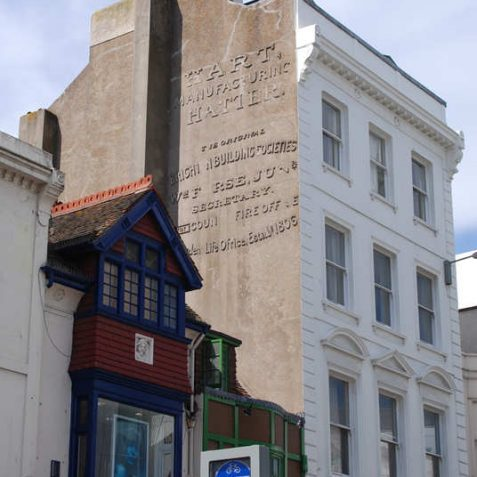 Advertising on the building.  Top is for Hart's the hatters.  Bottom is for the Brighton Building Society, 1806 | Photo by Tony Mould