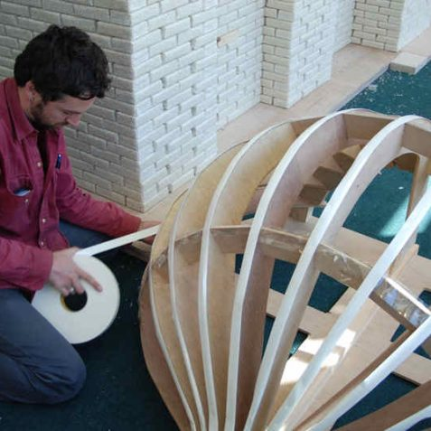 Guyan fixes industrial strength double sided tape to the dome | Photo by Tony Mould
