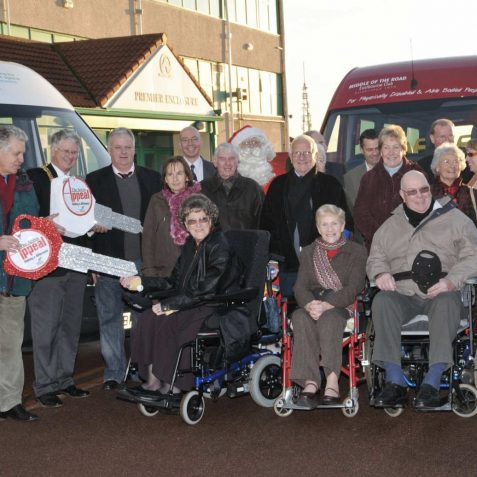 Nicholas Owen, TV newsreader and Chairman of the Argus Appeal hands a key over to the Alzheimer Society for a new bus. | Photo by Tony Mould