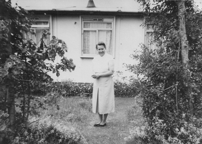 My mum in the back garden of our prefab | From the private collection of Alan Drake