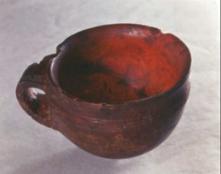 The Hove Amber Cup is considered to be one of Britain's most important Bronze Age finds. It was discovered in 1856 when a burial mound was excavated to make way for the building of Palmeira Avenue. Inside the mound was an oak coffin carved from a single tree trunk. The coffin contained bone fragments, a dagger, a whetstone and an axe head as well as the precious Amber Cup. The grave goods are over 3,500 years old. | Royal Pavilion and Museums Image Store