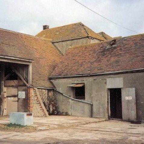Ovingdean Hall Farm knapped and squared flint barn before renovation | Photo by Jennifer Drury
