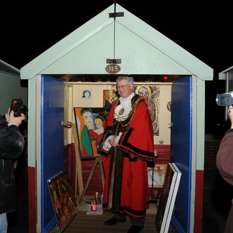 The Mayor, Councillor Garry Peltzer Dunn visits the Advent Beach Hut Calendar.  Beach hut owners who participated put on a Christmas display and entertained their guests with mulled wine and mincepies | Photo by Tony Mould