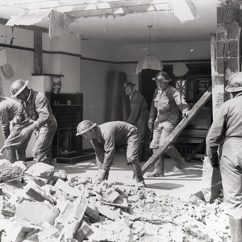 Civil Defence volunteers search through the rubble of an unidentified  house destroyed in an air raid. | Reproduced courtesy of  Royal Pavilion, Libraries & Museums, Brighton & Hove