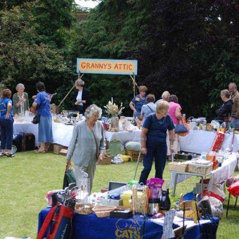 Well laden stalls in the church fete | Photo by Tony Mould