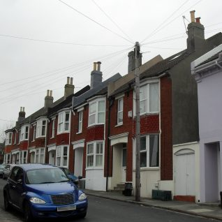 Houses at the north end of Belton Road, Round Hill; built in the early 20th century of brick, unlike the stuccoed houses found in the rest of the suburb. Some bricks came from the former Tower Mill which stood on the site until its demolition in 1913. | The Voice of Hassocks:Click on image to open large version