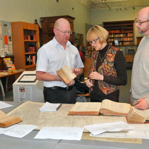 Paul Jordan, Senior History Centre Officer, Jennifer and Spooks Drury using the centre resources | Photo by Tony Mould