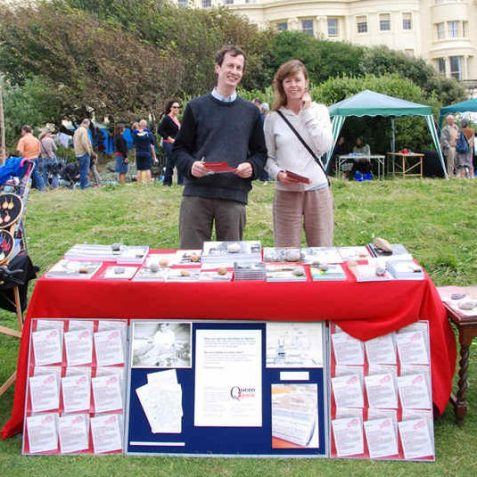Jack Latimer (My Brighton and Hove) and volunteer Jane, on the QueenSpark stall | Photo by Tony Mould
