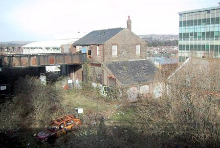 Behind John's Camping from the road (now demolished) leading to the Station Car park, 15/1/2004. New England House can be seen on the right; the Clarenden Centre to the left; and the viaduct in the distance. | © Alan (Fred) Pipes