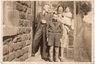 Photo of Bobby Gunn with his foster family, the Downs, in 1941 | From a private collection