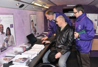 Brian and Dave from the census bus team show Spooks the Census website | Photo by Tony Mould