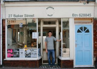 The shop is still a hairdressers owned by Julian who kindly posed for us | Photo by Tony Mould