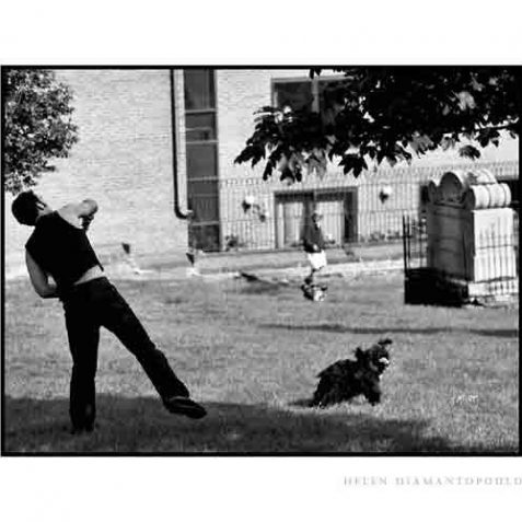 Male playing with his dog in St Nicholas Church graveyard | Photo by Helen Diamantopoulo