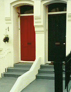 A photo of painted doors in Vere Road, Brighton