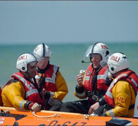 Crew of RNLI Shoreham rescuing an ice cream! | Sean Clark / underwaterimage.co.uk