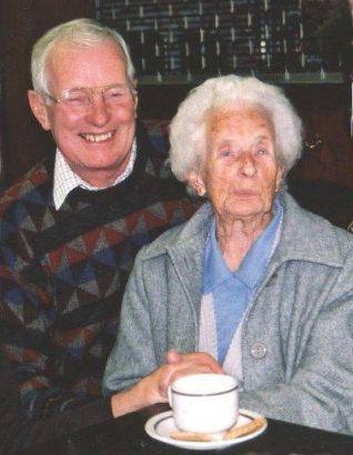 Daisy and her son Denis pictured in Ovingdean Village Hall (2000) at the launch of the oral history book for which she was interviewed | From the private collection of Jennifer Drury