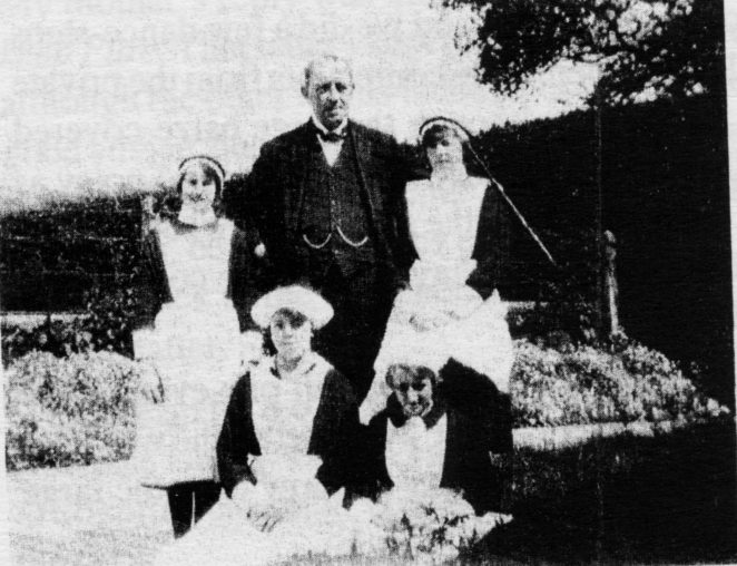 Daisy Noakes (standing left) in her formal uniform in the school grounds | From the private collection of Jennifer Drury