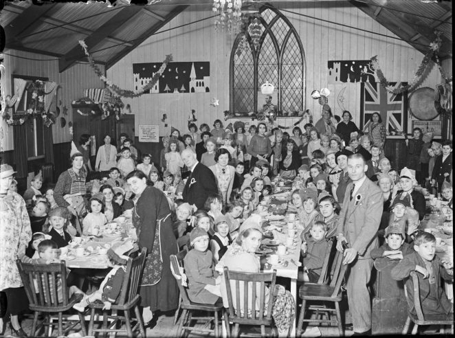 Monochrome glass plate negative from the Herald collection. Showing an image of the New Year Children's Party of the Bevendean Rate Payers, St Andrews Hall, Moulsecomb 1 January, 1938. | Royal Pavilion and Museums Brighton and Hove