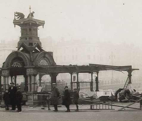 Destruction of the clock on top of Brighton aquarium in November 1928. The tower was demolished by tying ropes to it and pulling. It is often thought the clock was moved to the <a href=