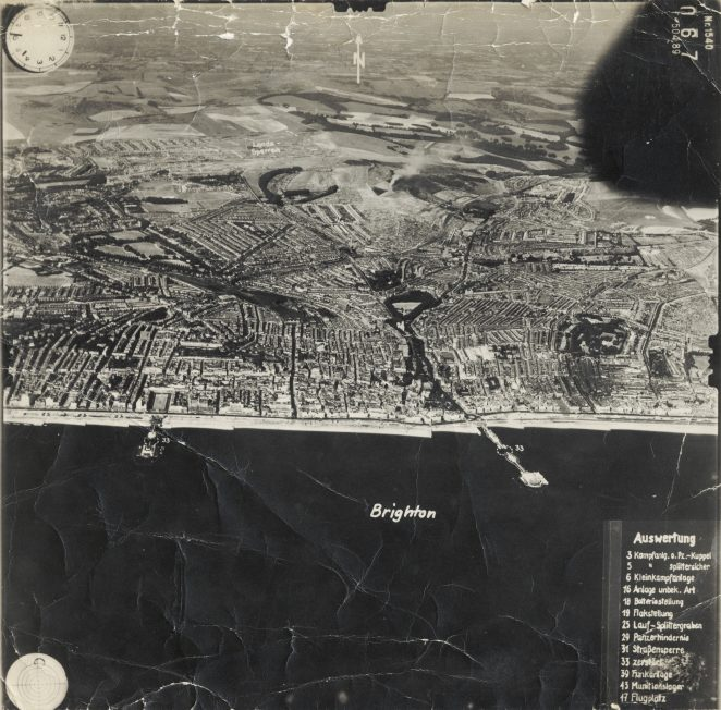 Monochrome photograph showing an aerial view of Brighton from above the English Channel, 1940. Features numerical key in German. | Royal Pavilion and Museums: Brighton and Hove