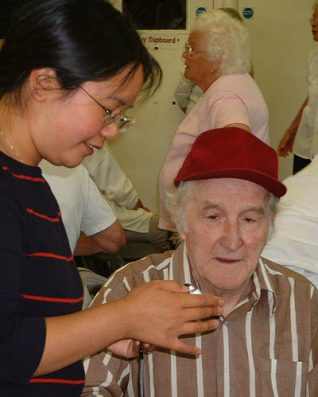 Sandra shows Eddie how the mini-disc recorder works | Photographs taken by Zoë Woods and Sandra Koa Wing