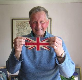 Tony Simmonds holding the flage he flew on his bike on VE Day | Photograph taken by Zoe Woods