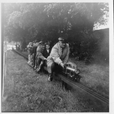 Hove Park Railway in 1953. Charlie Hudson (leading) and Bert Perryman carry a happy crowd on Coronation day June 1953. | B&HSMLE Archive