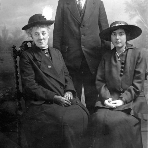 Victoria May Griffiths with her parents c1918. Both women are wearing Royal Sussex Regiment badges. | Private Collection of Geoffrey Barber