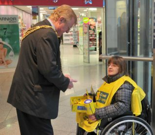 Volunteer collector in Churchill Square centre | Photo by Tony Mould