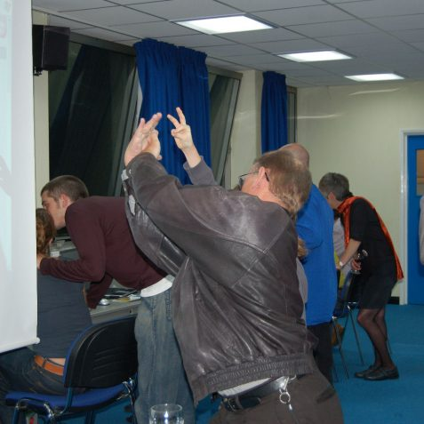 Local historian Geoffrey Mead finds a novel use for the projector screen. | Photo by Tony Mould