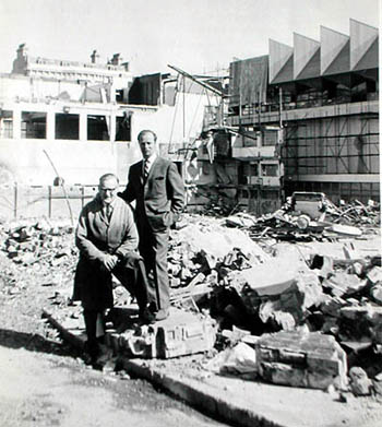 Rear view of the Sports Stadium demolition in 1965. This photo shows George Miller and Len at the back of the Sports Stadium in Little Russell Street in the final stages of its demolition.Len ran a small engineering business in Little Russell St and was well known by everyone at the rink for skills at honing ice skates to the precise level required to grip the ice. Many of the stars appearing at the rink took their skates there personally to have them sharpened and particularly the