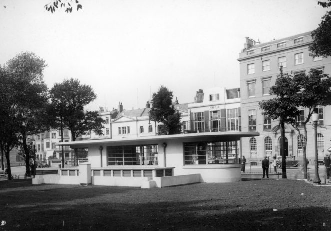 Monochrome photographic print showing the public lavatories in the Old Steine, Brighton, which were closed and converted into a cafe in 1999. The lavatory vents at the rear of the building were demolished. This view also shows the building on the right before balconies were added. | Royal Pavilion and Museums Brighton