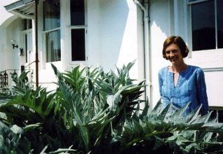 Sue with her magnificent cardoon plant in the front garden of No. 20 | Photo taken by Rosie Page