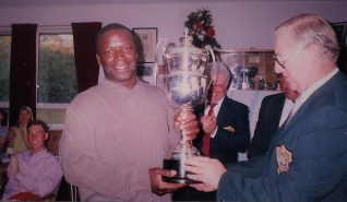 Club member Howard St Clair receiving the Festival Cup from Captain Reg Morton | HPGC Archive